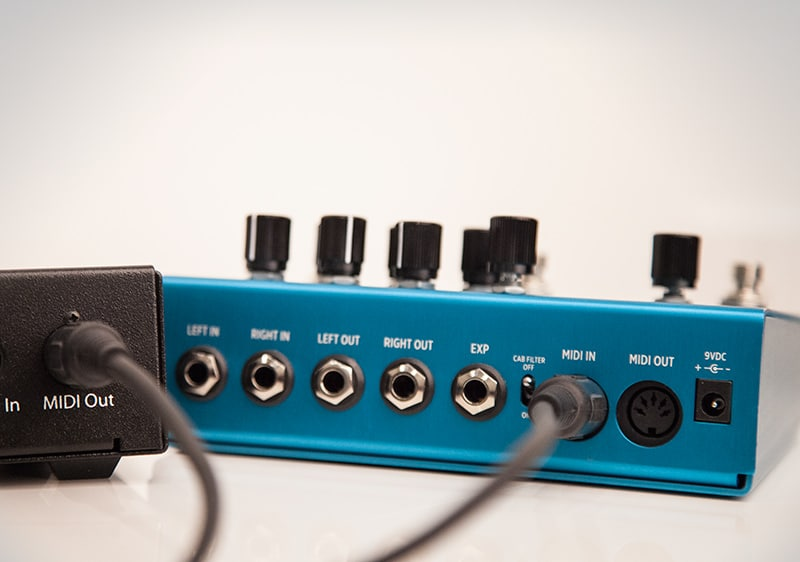 MIDI cable plugged into Strymon pedal and MIDI controller